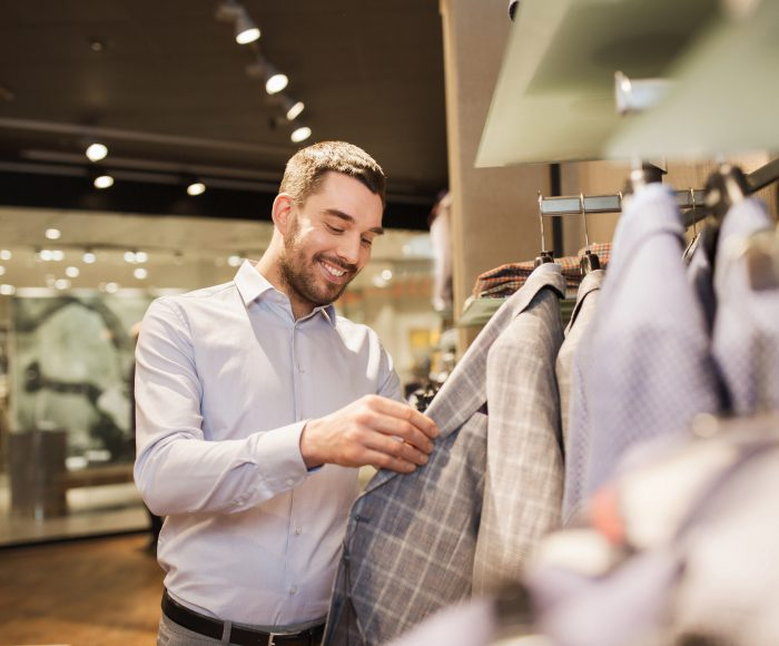 man choosing clothes in clothing store